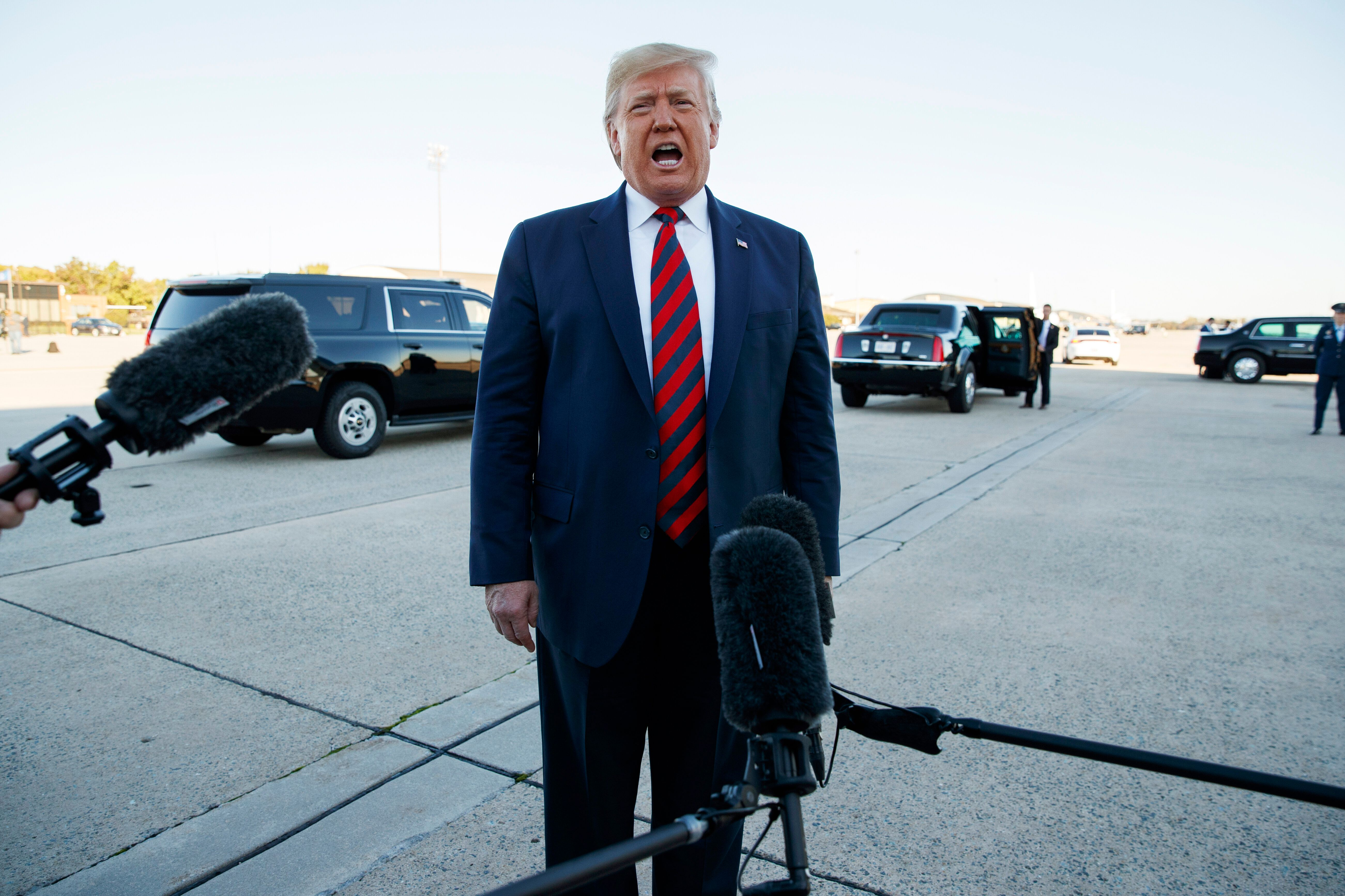 """President Donald Trump tells reporters Monday before boarding Air Force One for Chicago, """"I guess we're in record"""