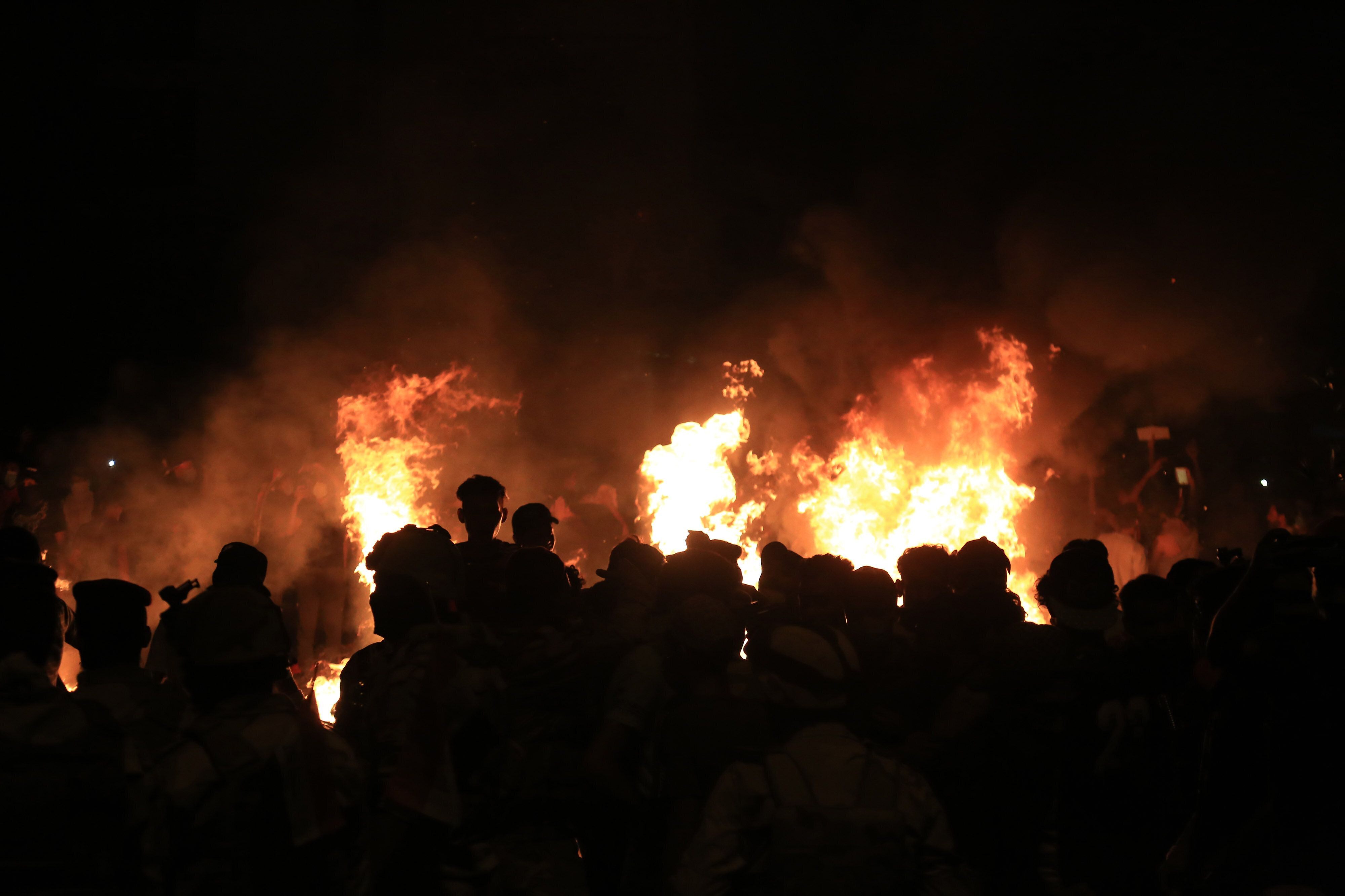 Burning tires light up the night skies during anti-government protests in the Shiite shrine city of Karbala on Monday night.