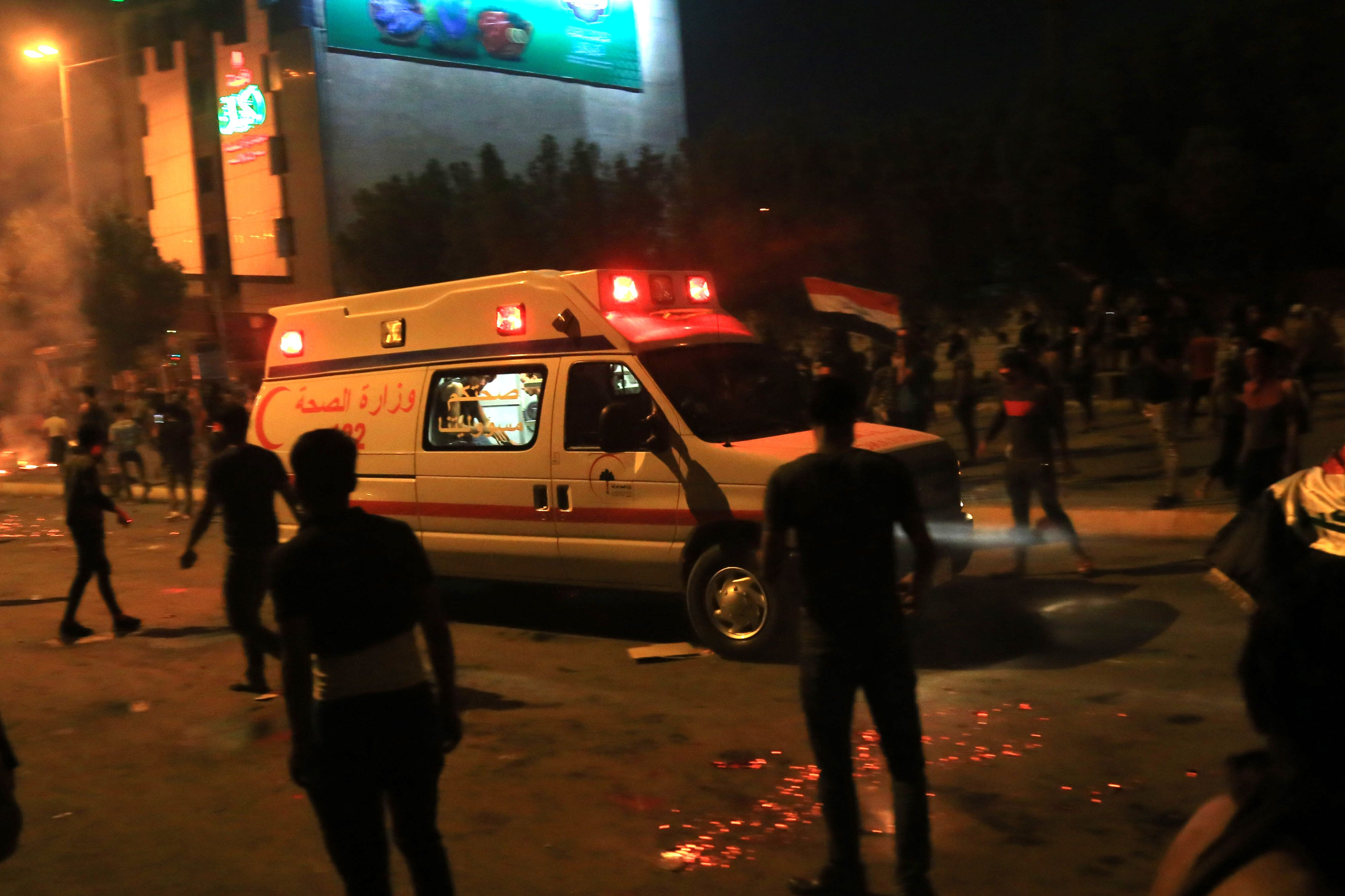 Soldiers were seen beating high school students with batons in two Baghdad districts.
