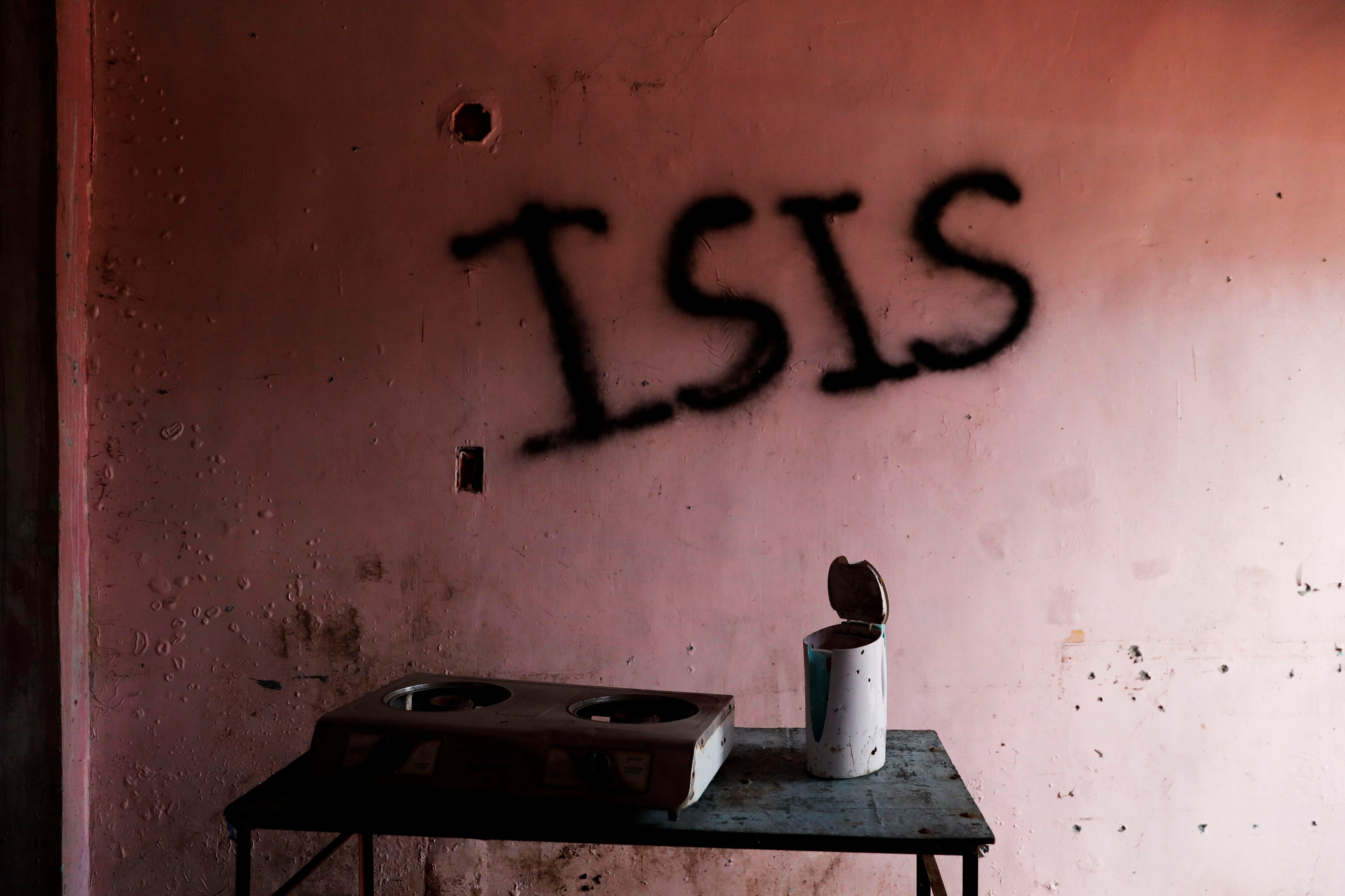 """Pro-Islamic State groups operate outside of Syria and Iraq. Here, the word """"ISIS"""" is seen spray-painted in a home in Marawi C"""
