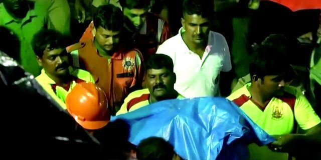Search teams recover the body ofSujith Wilson, 2, after he fell down a well Friday.