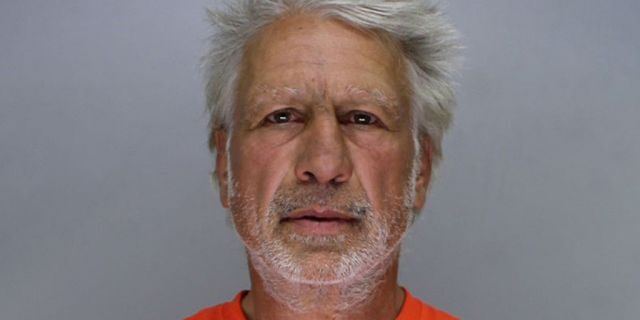 Mugshot for hockey star Mark Pavelich, 61.