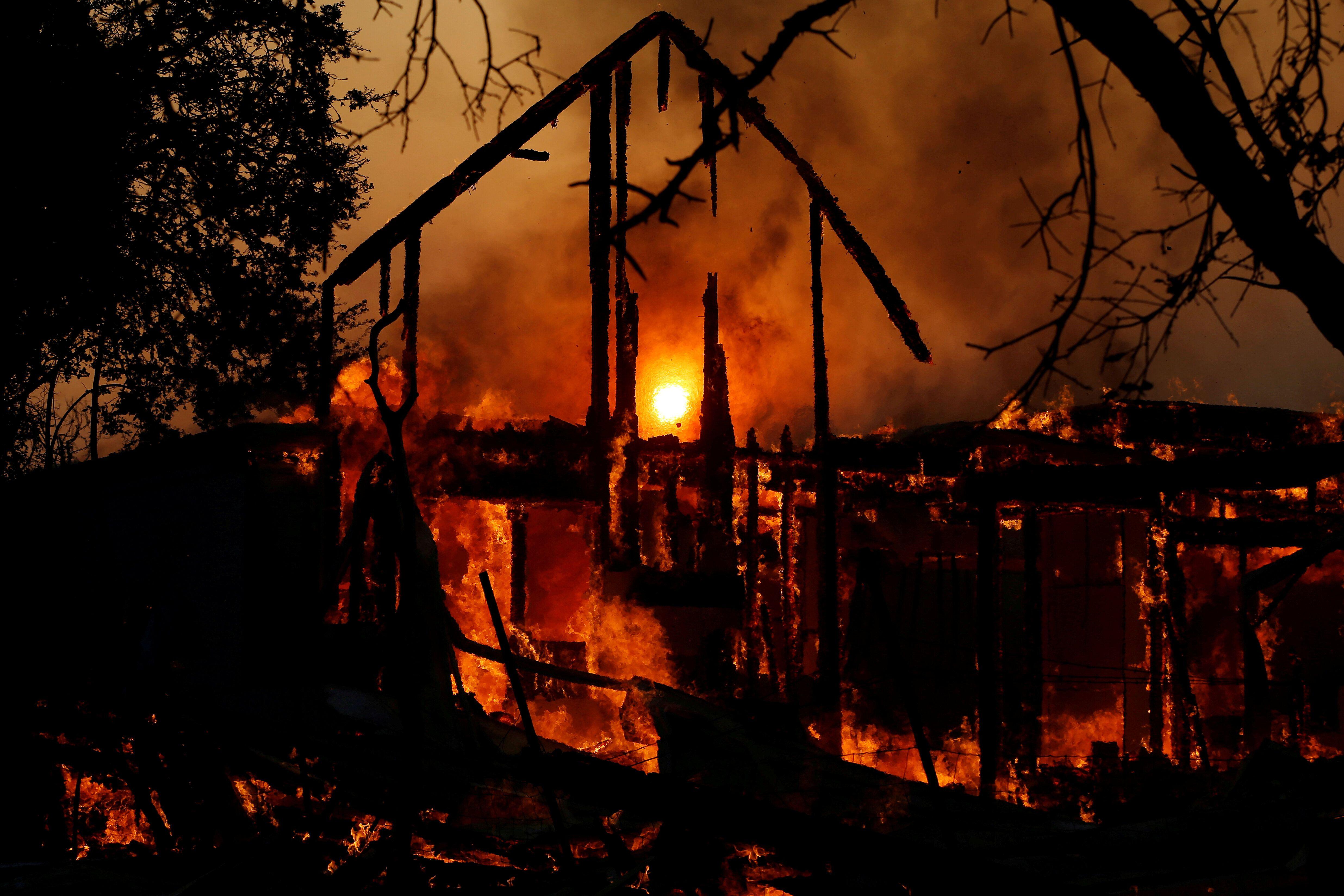 A structure burns in the wind-driven Kincade fire in Healdsburg, California, on Sunday.