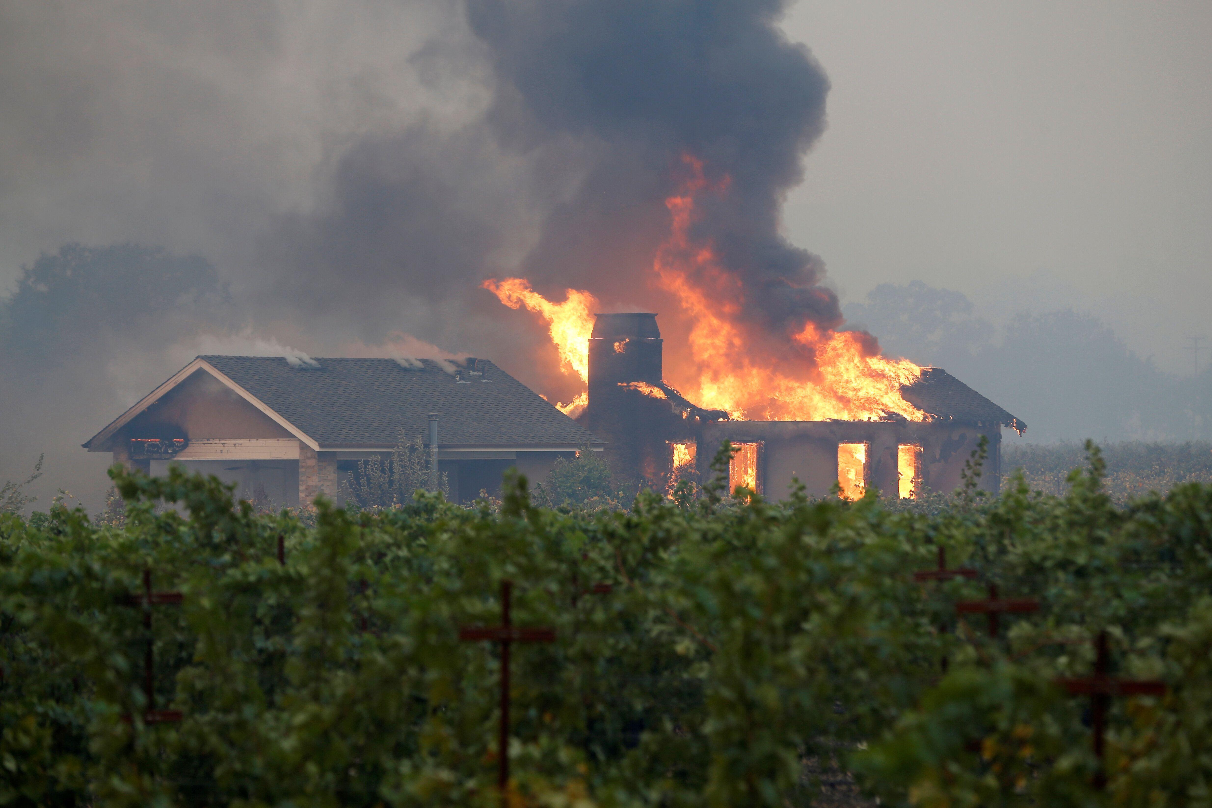 A building burns Thursday during the Kincade fire in Geyserville, California.