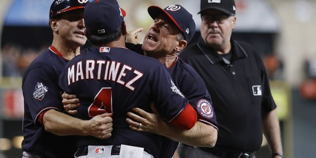 Washington Nationals manager Dave Martinez has to be restrained after being ejected for arguing an interference call during the seventh inning of Game 6 of the baseball World Series against the Houston Astros Tuesday, Oct. 29, 2019, in Houston. (Associated Press)