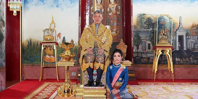 This undated photo posted Monday, Aug. 26, 2019 on the Thailand Royal Office website shows King Maha Vajiralongkorn with Major General Sineenat Wongvajirapakdi, the former royal noble consort. (Thailand Royal Office via AP)