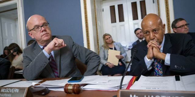 House Rules Committee Chairman Jim McGovern, D-Mass., left, joined by Rep. Alcee Hastings, D-Fla., presides over a markup of the resolution that will formalize the next steps in the impeachment inquiry of President Donald Trump, at the Capitol in Washington, Wednesday, Oct. 30, 2019. Democrats have been investigating Trump's withholding of military aid to Ukraine as he pushed the country's new president to investigate Democrats and the family of rival presidential contender Joe Biden. (AP Photo/J. Scott Applewhite)