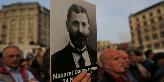 In this April 24, 2019, file photo, protesters hold portraits of Armenian intellectuals during a rally held to commemorate the 104th anniversary of the 1915 mass killing of Armenians in the Ottoman Turks in Istanbul. The House voted overwhelmingly to recognize the century-old mass killings of Armenians by Ottoman Turks as genocide. (AP Photo/Lefteris Pitarakis, File)