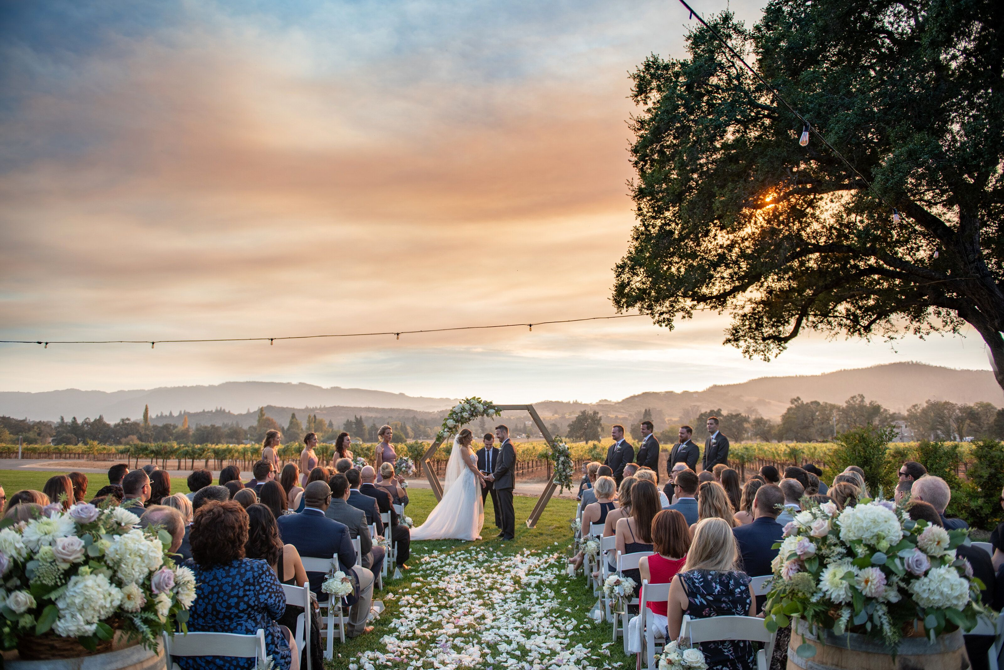 The couple's ceremony backed by a smoky sunset.