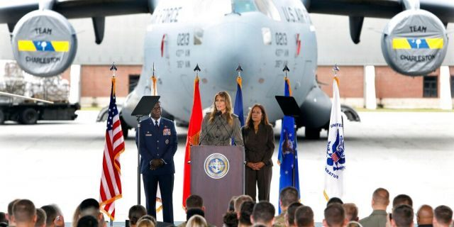 First lady Melania Trump addresses military members and their families on Wednesday, Oct. 30, 2019, at Joint Base Charleston, S.C. Listening are Col. Terrence Adams, left, and Karen Pence, wife of Vice President Mike Pence. (AP Photo/Mic Smith)