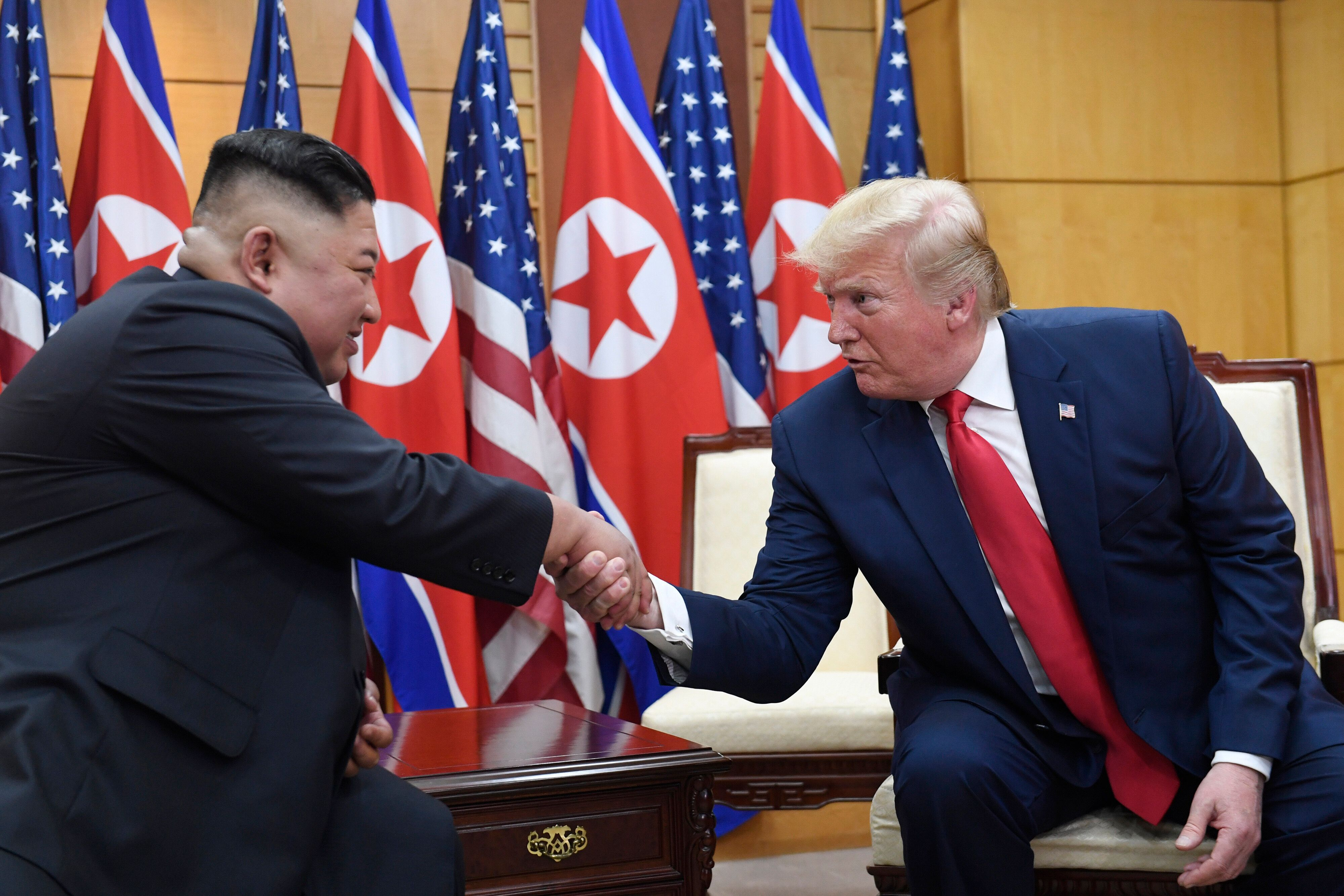 FILE - In this June 30, 2019, file photo, U.S. President Donald Trump, right, meets with North Korean leader Kim Jong Un at t