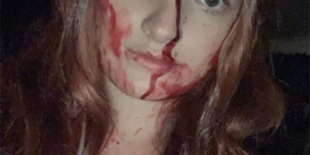 """Student Sidney Wolfe gave first responders a scare when she totaled her car and they arrived to see her covered in fake blood from her """"Carrie"""" costume."""