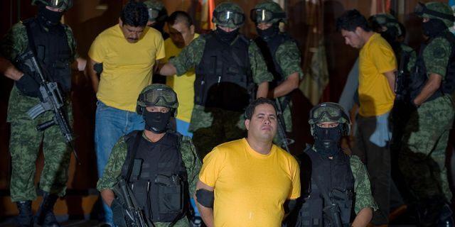 Accused drug trafficker Jose Rodolfo Escajeda, center, presented to the media in Mexico City, in 2009. Rodolfo Escajeda and other members of the Juarez cartel were arrested in Casas Grandes, Mexico. (ALFREDO ESTRELLA/AFP via Getty Images, File)