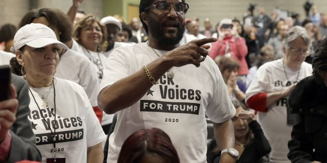 "Supporters of President Donald Trump wait to listen to him speak during the launch of ""Black Voices for Trump,"" at the Georgia World Congress Center, Friday, Nov. 8, 2019, in Atlanta. (AP Photo/ Evan Vucci)"