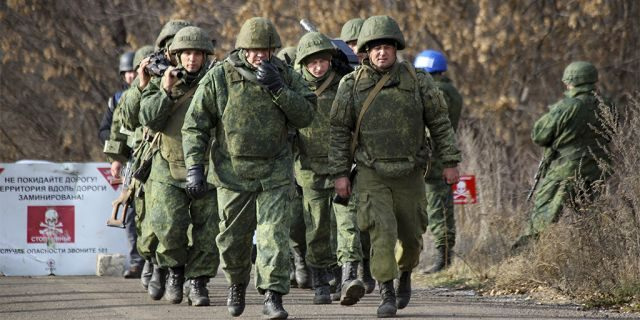 A Russia-backed separatist rebel unit left to take their position at a new line of contact outside Petrivske on Saturday. (AP Photo/Alexei Alexandrov)