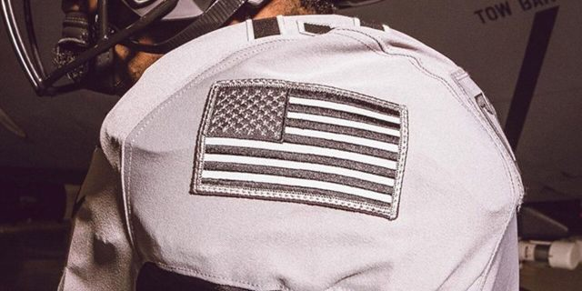 The American flag is sewn into the left sleeve of the jerseys.