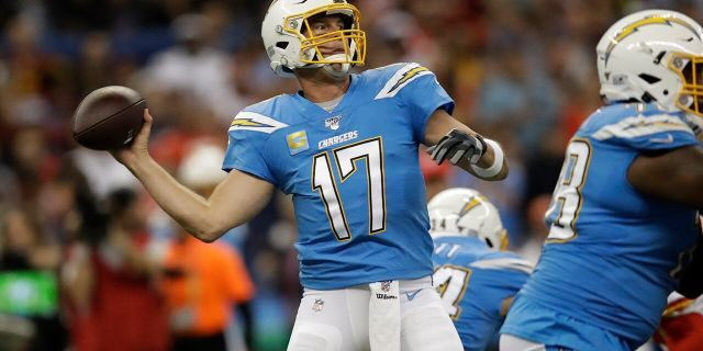 Los Angeles Chargers quarterback Philip Rivers throws a pass during the first half of an NFL football game against the Kansas City Chiefs Monday, Nov. 18, 2019, in Mexico City.