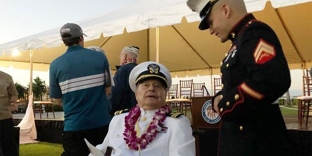 Marine Cpl. Zachariah Jeavons, 22, of Binghamton, N.Y., meets Pearl Harbor survivor Lou Conter, 98, who was aboard the USS Arizona when the Japanese attacked in 1941, Saturday, Dec. 7, 2019 at Pearl Harbor, Hawaii on the 78th anniversary of the attack. (AP Photo/Caleb Jones)