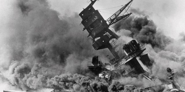 FILE - In this Dec. 7, 1941, file photo, smoke rises from the battleship USS Arizona as it sinks during the Japanese attack on Pearl Harbor, Hawaii. (AP Photo, File)
