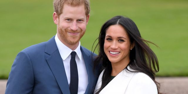 Prince Harry and Meghan Markle attend an official photocall to announce their engagement at The Sunken Gardens at Kensington Palace on November 27, 2017, in London, England.