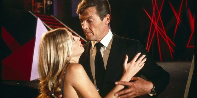 "Actor Roger Moore and actress Britt Ekland on the set of ""The Man with the Golden Gun.'"
