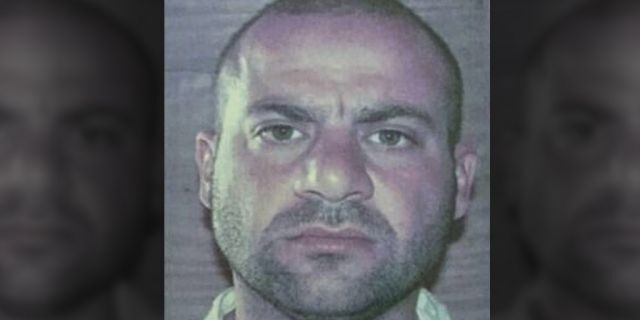 This undated mugshot shows Amir Mohammed Abdul Rahman al-Mawli al-Salbi, likely taken while he was detained by U.S. forces in southern Iraq's Camp Bucca prison, Iraq.