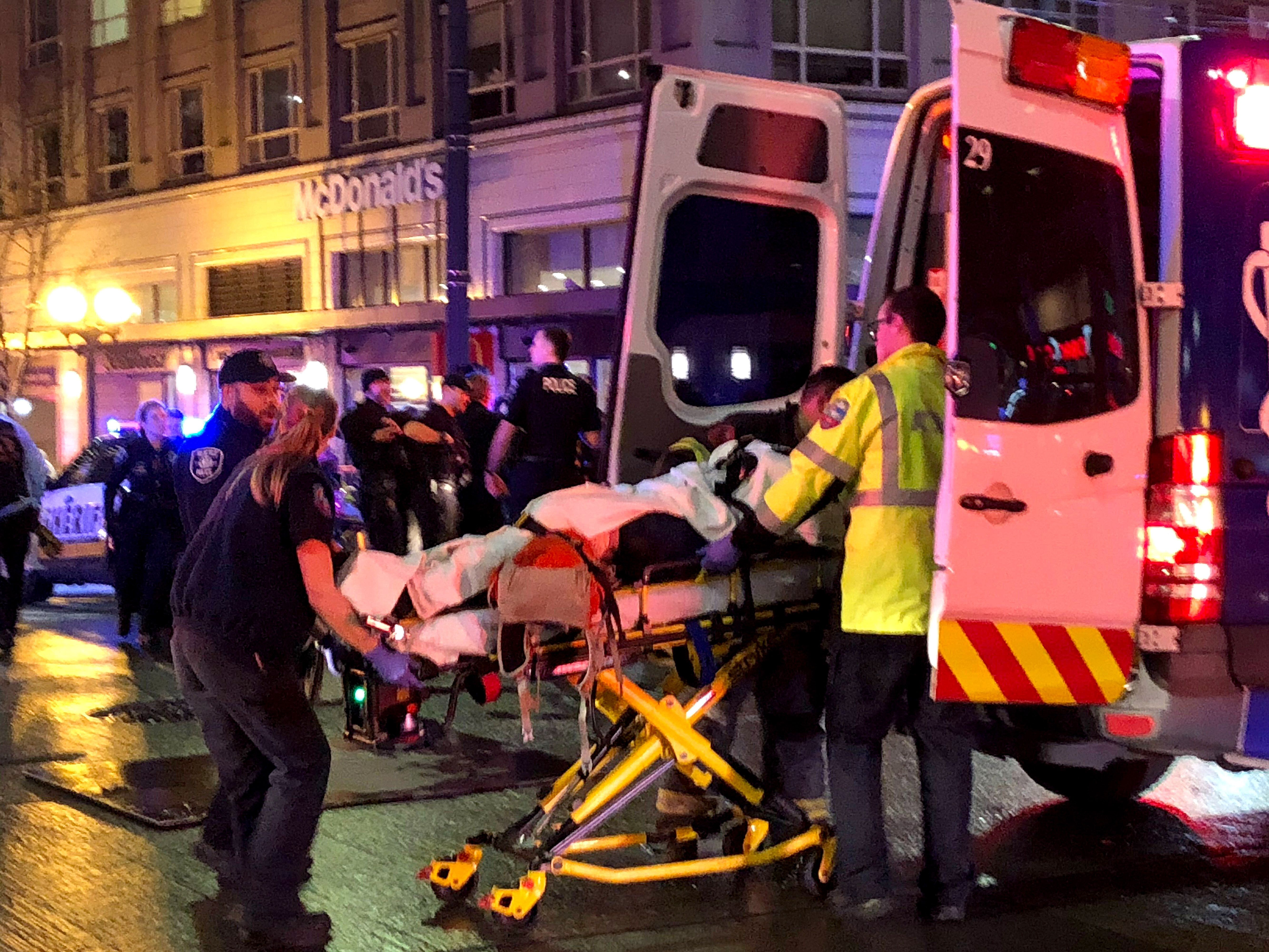 First responders give aid to a shooting victim in downtown on January 22, 2020 in Seattle, Washington.