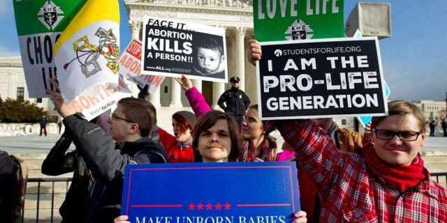 FILE - In this Jan. 18, 2019, file photo, anti-abortion activists protest outside of the U.S. Supreme Court, during the March for Life in Washington. (AP Photo/Jose Luis Magana, File)