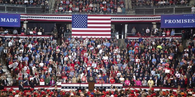 President Trump speaking at his campaign rally Monday in Manchester, N.H. (AP Photo/Mary Altaffer)