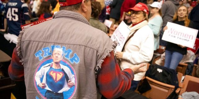 Supporters waiting for the start of President Trump's rally Monday in Manchester, N.H. (AP Photo/Mary Altaffer)