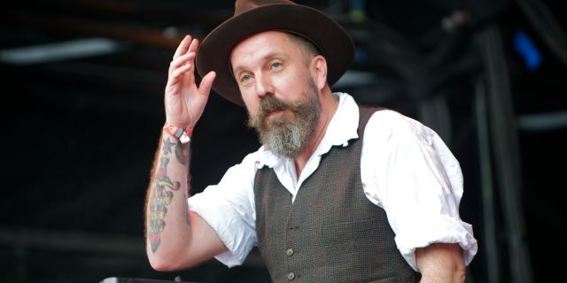 Andrew Weatherall performs DJ set on stage during The Apple Cart Festival 2011 at Victoria Park on August 7, 2011 in London, United Kingdom. (Photo by Hayley Madden/Redferns)