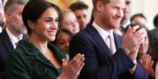 Meghan, Duchess of Sussex, left, and Britain's Prince Harry, Duke of Sussex, watch a musical performance at Canada House, the offices of the High Commission of Canada in the United Kingdom, during an event to mark Commonwealth Day, in central London, on March 11, 2019. (CHRIS JACKSON/AFP/Getty Images)