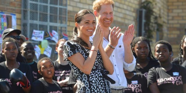 Prince Harry and Meghan Markle greet youths on a visit to the Nyanga Methodist Church in Cape Town, South Africa, Monday, Sept. 23, 2019. (Courtney Africa / Africa News Agency via AP, Pool)