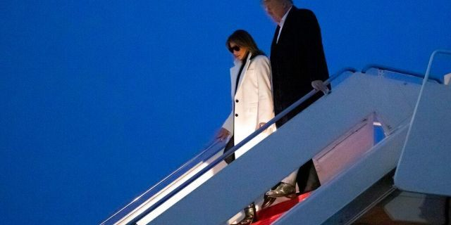President Donald Trump, and first lady Melania Trump, step off Air Force One upon arrival, Wednesday, Feb. 26, 2020, at Andrews Air Force Base, Md. Trump is returning from India. (AP Photo/Alex Brandon)