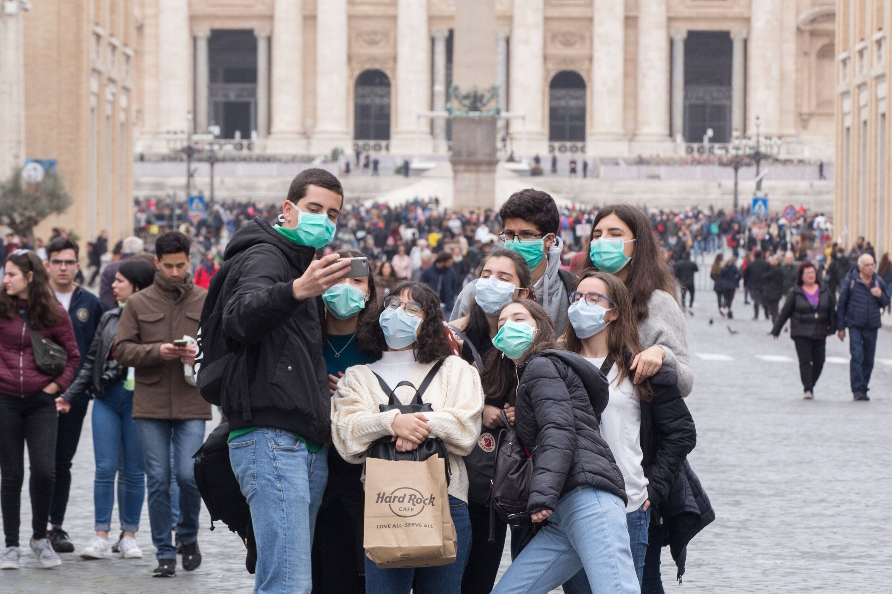 People wear face masks to protect themselves while visiting the Vatican on Ash Wednesday.