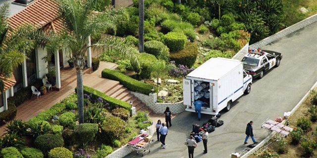 A truck containing some of the bodies of the Heaven's Gate cult, which committed mass suicide, is shown outside the cult's compound in San Diego, Calif. (AP Photo)