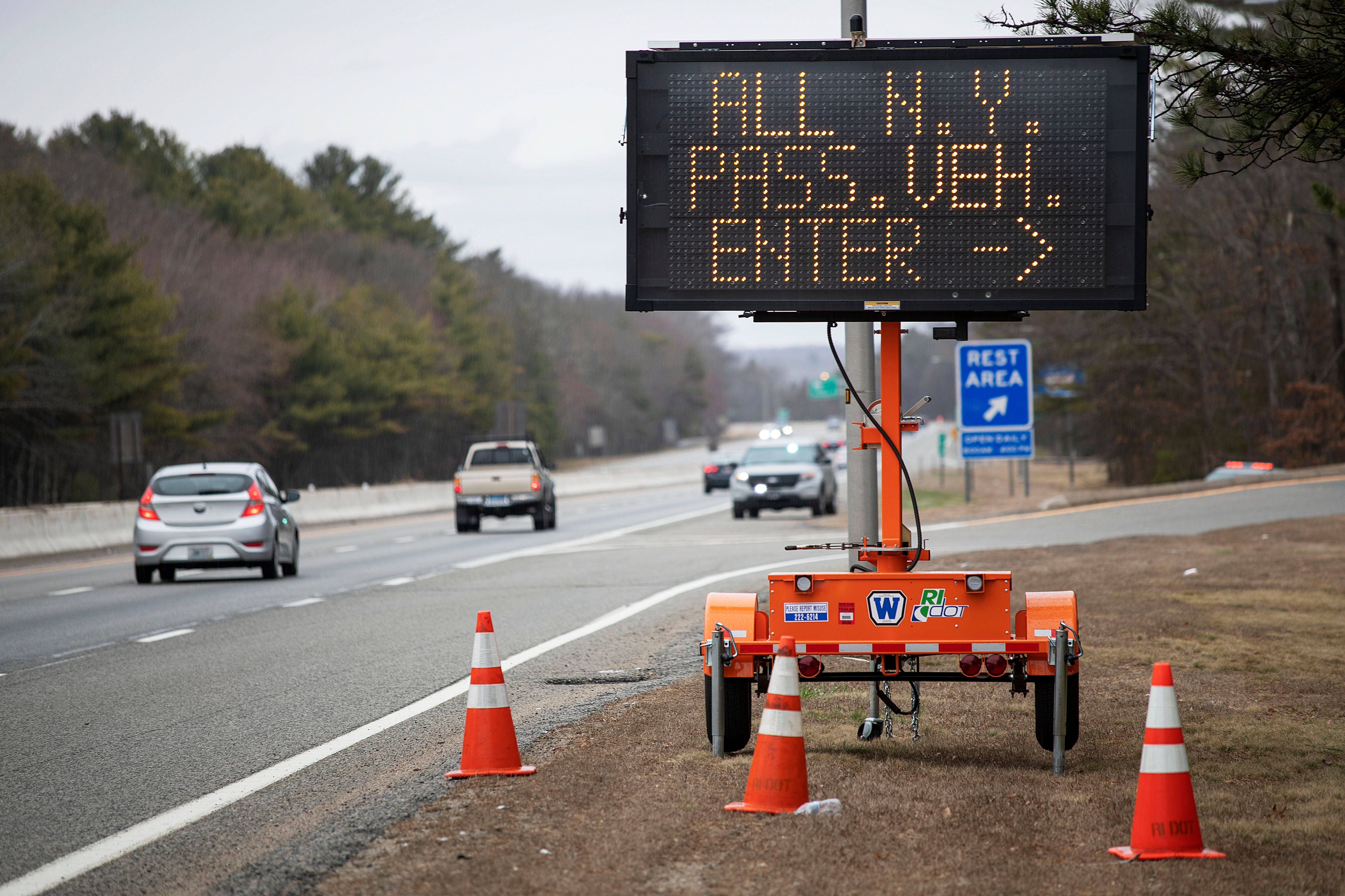 A sign tells motorists with New York license plates to pull over at a checkpoint on I-95 in Rhode Island.