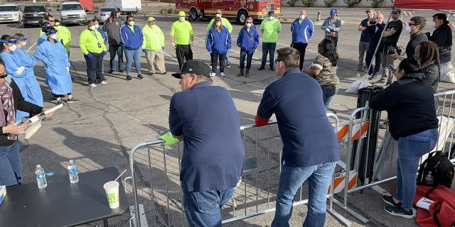 Volunteers and workers set up a temporary homeless shelter in a parking lot in Las Vegas on Saturday.