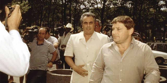 "John Gotti, center, enters the Brooklyn Federal courthouse with Sammy ""The Bull"" Gravano in New York City."