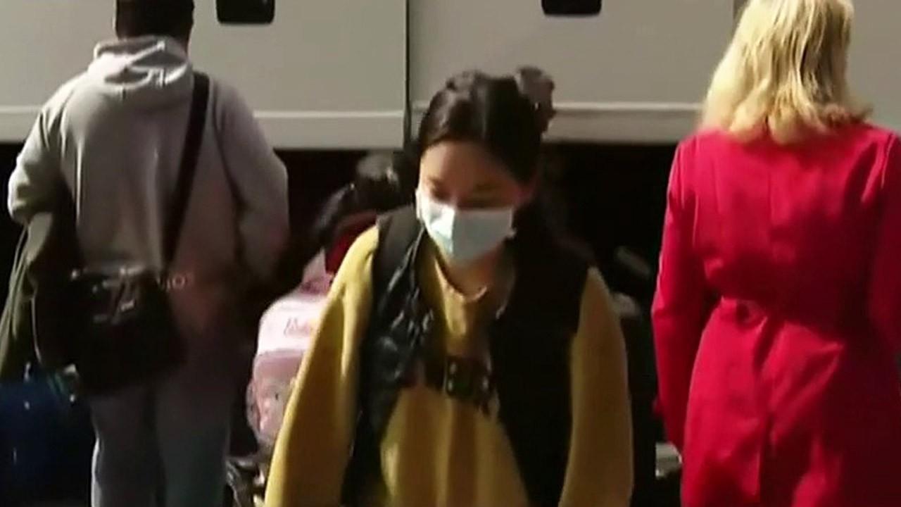 Passengers disembark cruise ship in Japan after 14-day coronavirus quarantine