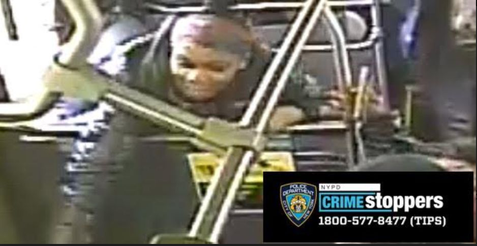 The unidentified female shown here struck the victim with an umbrella, according to police. The NYPD has asked anyone with in