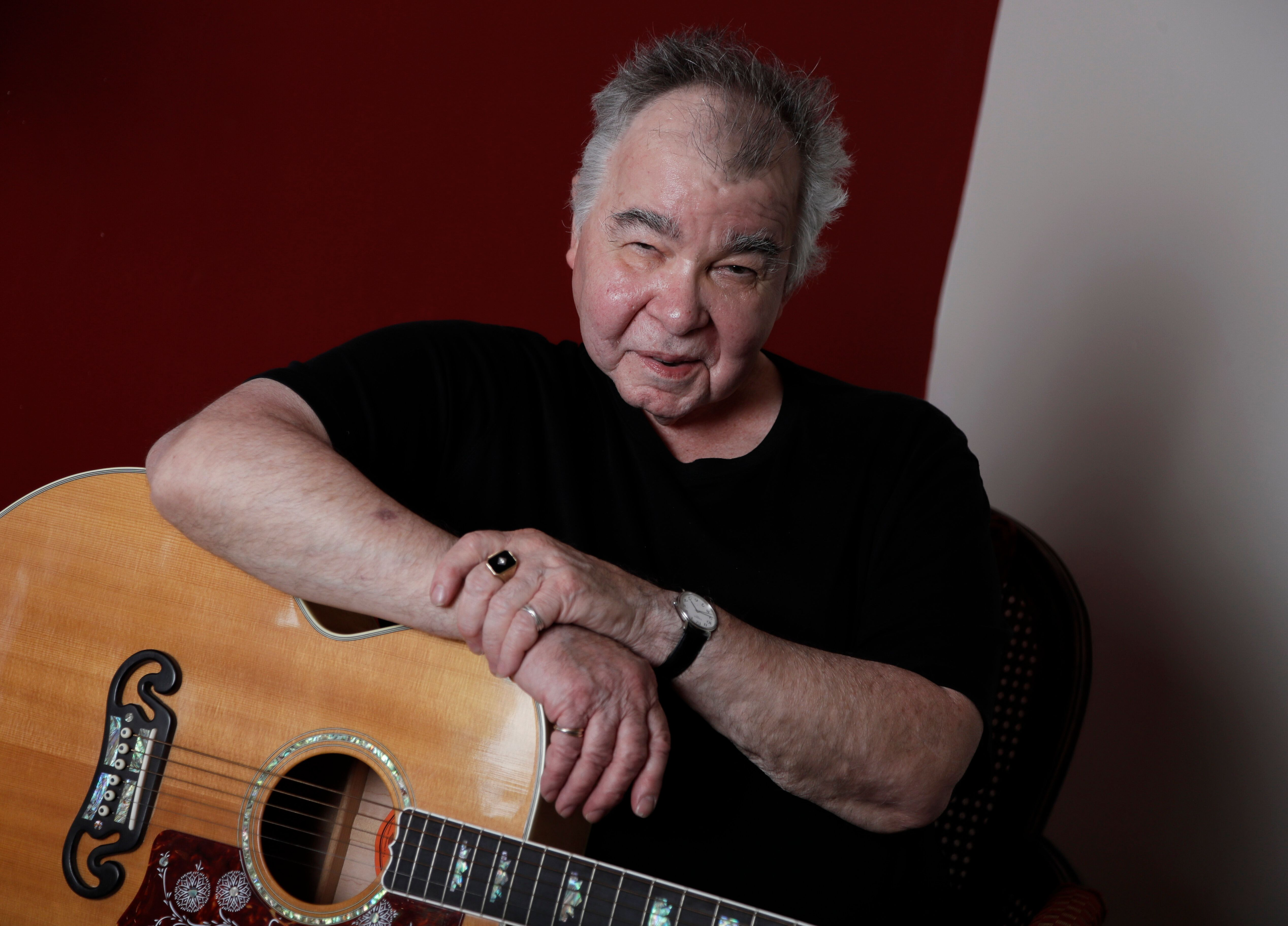 In this June 20, 2017, photo, John Prine poses in his offices in Nashville, Tenn. (AP Photo/Mark Humphrey)