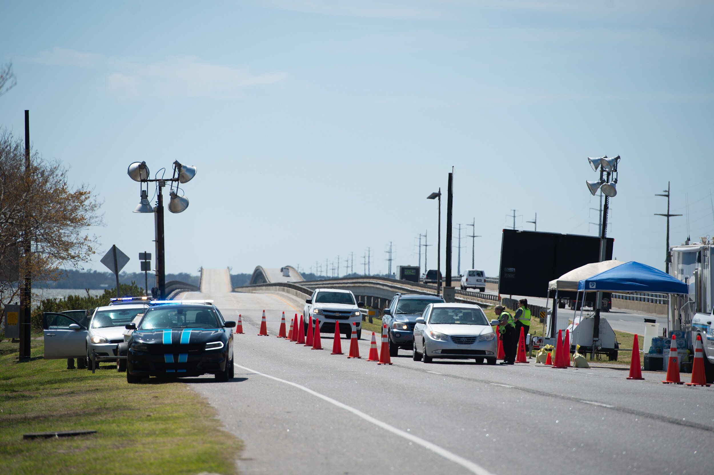 A roadblock checkpoint is set up in Kitty Hawk at the southern end of the Wright Memorial Bridge, which connects the Outer Ba