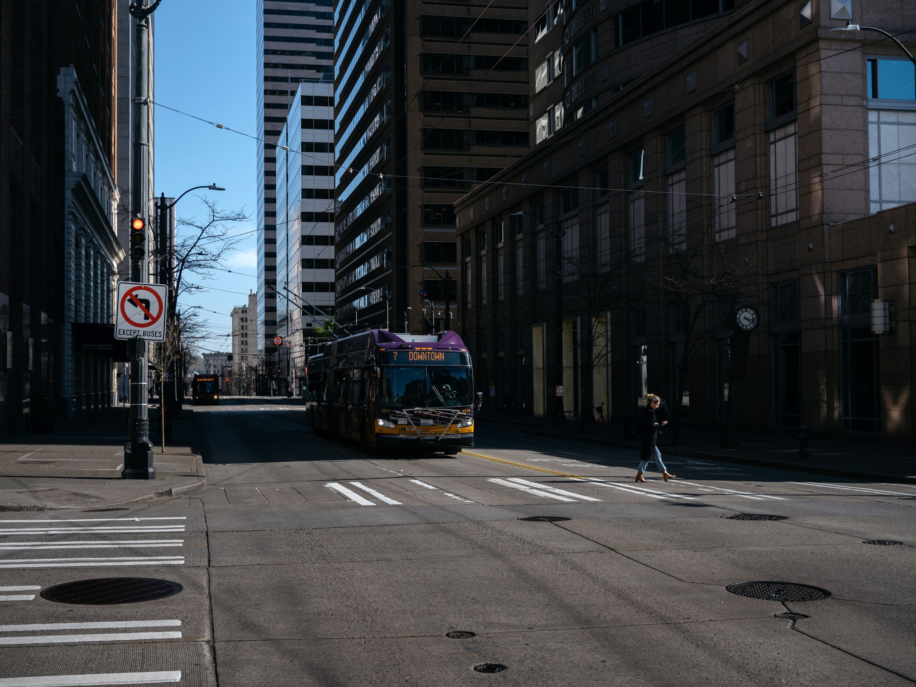 A King County Metro bus drives down 3rd Ave in downtown Seattle during what is usually rush hour.