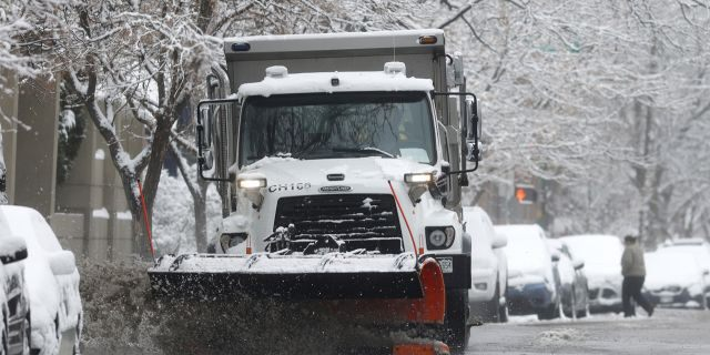 A City of Denver snowplow clears 1st Avenue after a spring storm swept over the region and dropped up to six inches of snow Thursday, April 16, 2020, in Denver.