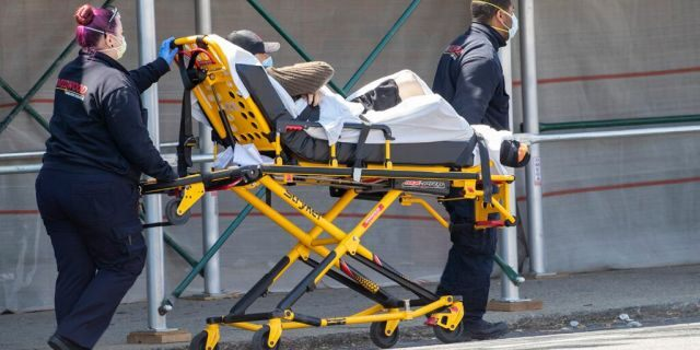 Medics transport a patient to the King David Center for Nursing and Rehabilitation in the Gravesend neighborhood of the Brooklyn borough of New York, Wednesday, April 15, 2020. Federal health officials are coming under increasing pressure to start publicly tracking coronavirus infections and deaths in nursing homes amid criticism they have not been transparent about the scope of outbreaks across the country that have already claimed thousands of lives.