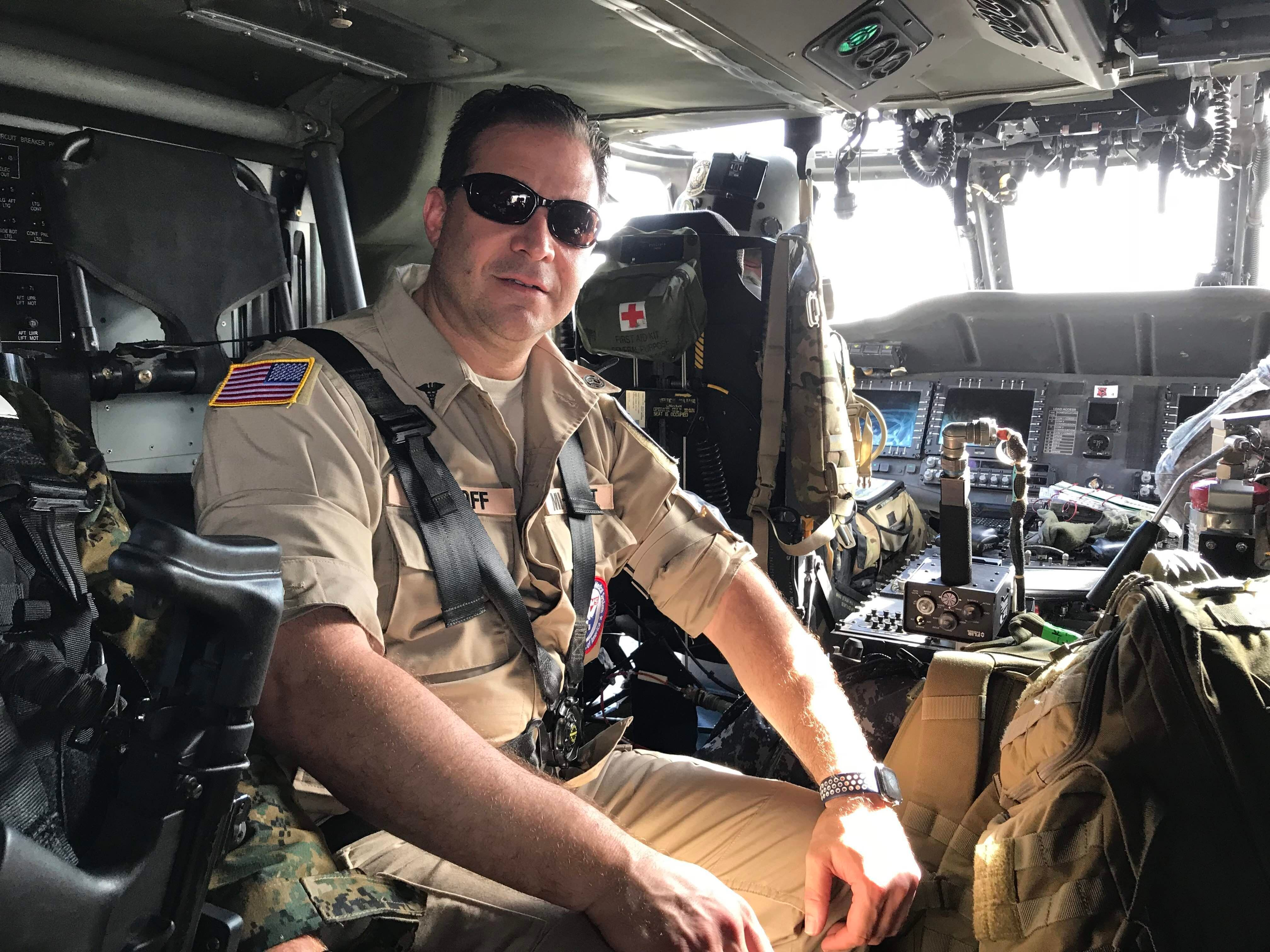 Dr. Steven Rockoff of Detroit on the military helicopter that ferried him and members of his team across Puerto Rico after Hu