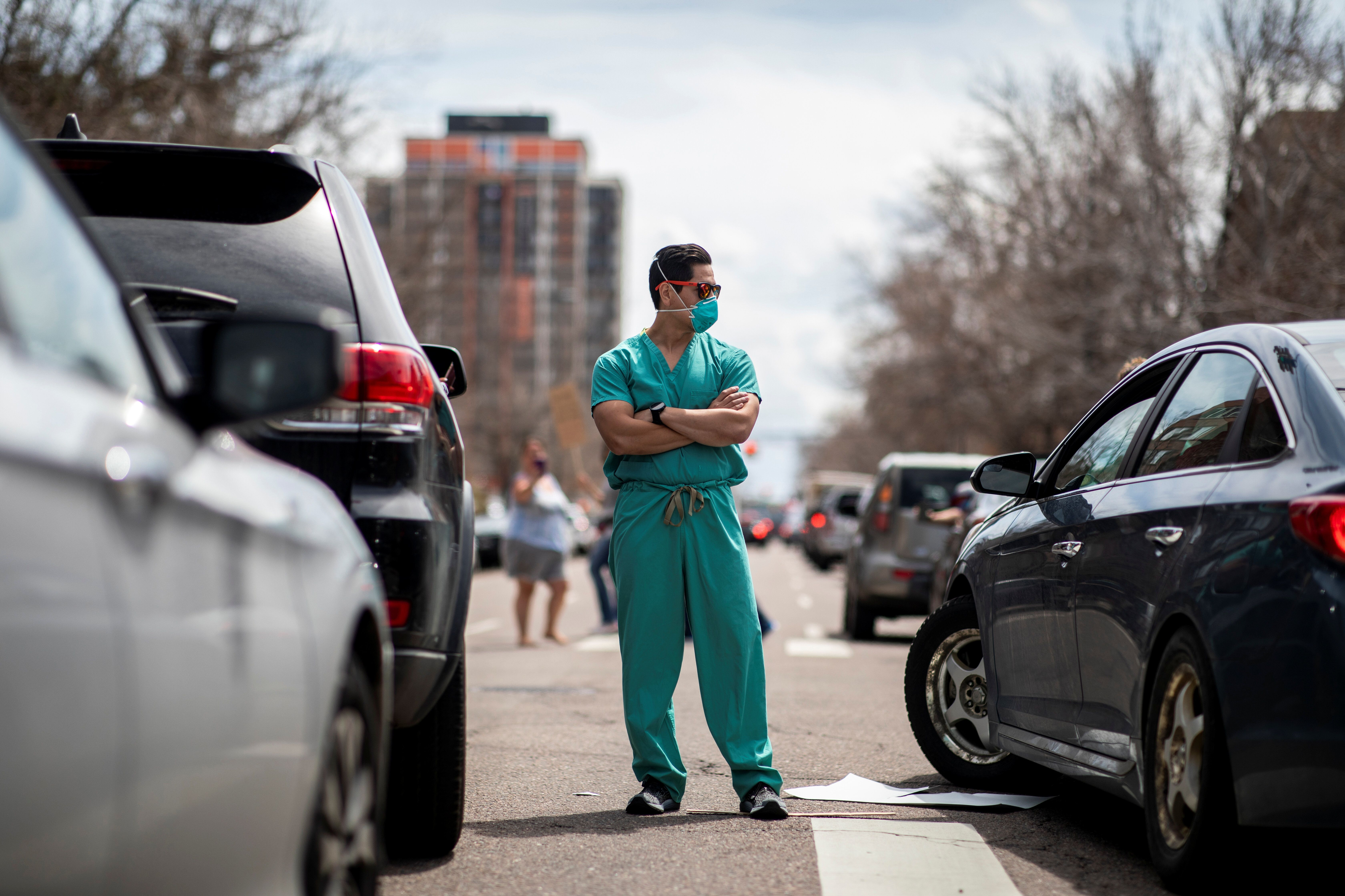"""Hundreds gathered in Denver on Sunday for what they called """"Operation Gridlock."""" A small cadre of health care workers opposed"""