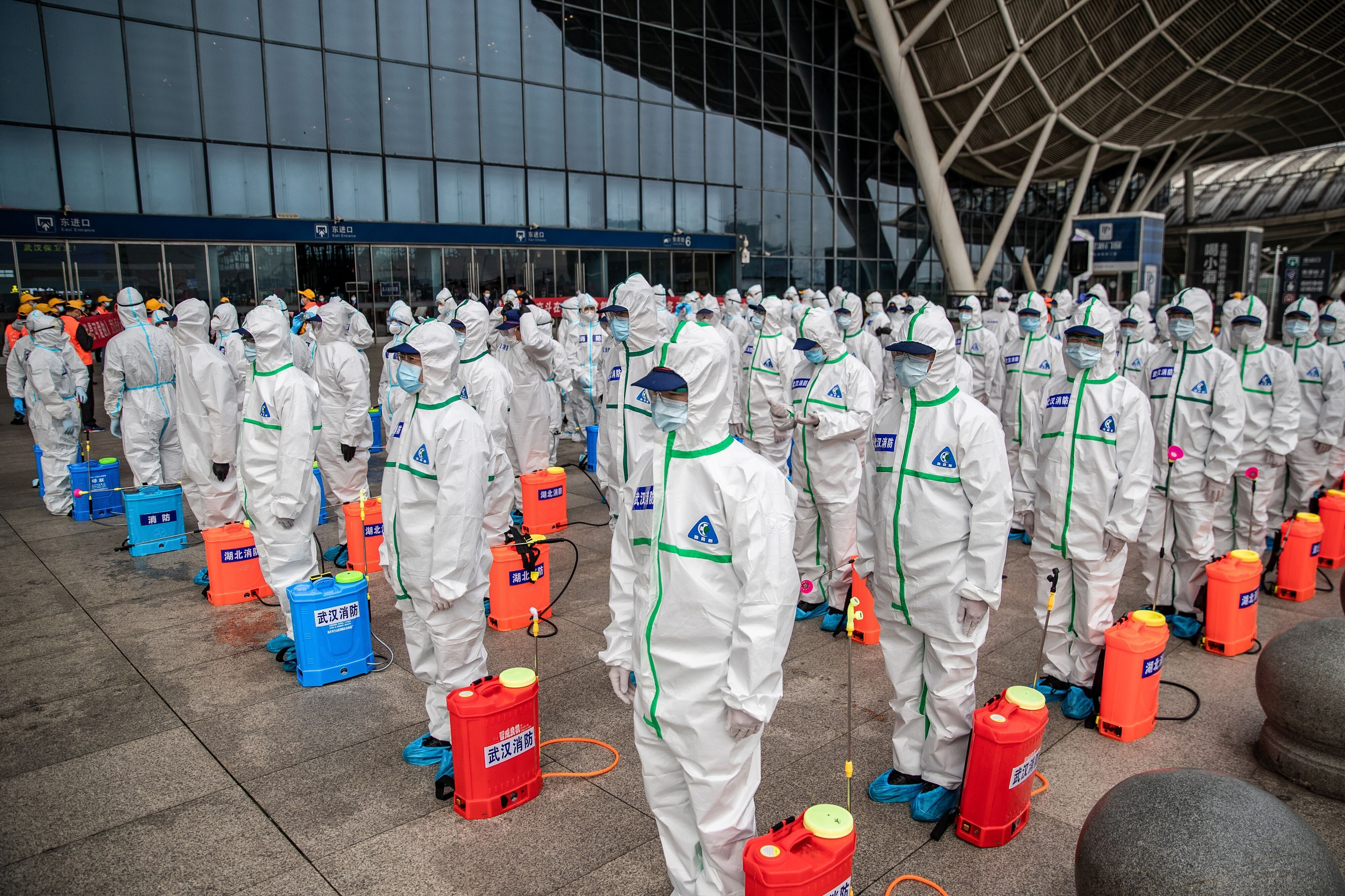 Workers prepare to spray disinfectant at the Wuhan Railway Station in Wuhan, China on March 24, 2020. The city in central Chi