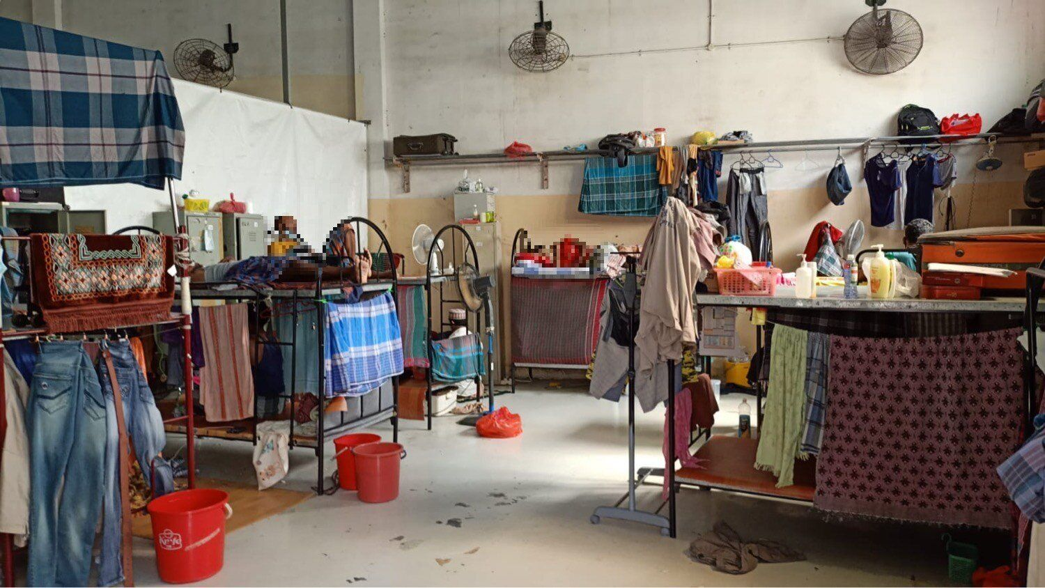 Seventeen men have been confined in this room at Kian Teck Crescent dormitory for 20 days. The men's images have been digital